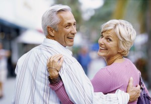 Rear view of a mature couple walking and smiling