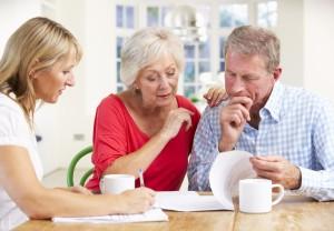 Couple, paperwork, advisor, retirement, planning, finance