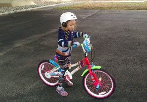 Miriam learns how to balance with the pedals removed from the bike.