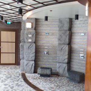 Izumi's utaseyu bath offers cascades of hot water.