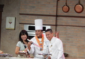 Japanese Entertainment Director Mikoko (l) translated Executive Chef Nilo Palma's (center) Culinary Show into Japanese.
