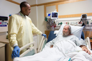 Pharmacist Dominick Bailey explains medication changes to patient Will Carter at the UCLA Medical Center in Santa Monica, California, on Thursday, May 5, 2016. The 79-year-old was admitted to the hospital with intense leg pain and worries he might mix up his medicine after he is discharged . (Heidi de Marco/KHN)