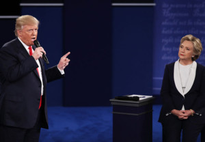 ST LOUIS, MO - OCTOBER 09:  Republican presidential nominee Donald Trump (L) speaks as Democratic presidential nominee former Secretary of State Hillary Clinton listens during the town hall debate at Washington University on October 9, 2016 in St Louis, Missouri. This is the second of three presidential debates scheduled prior to the November 8th election.  (Photo by Win McNamee/Getty Images)