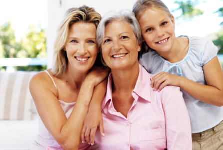 portrait of a grandmother; mother and daughter family caregiver