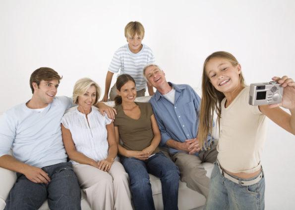Girl taking family portrait