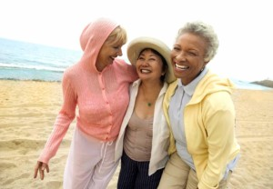 women-group-female-smiling-beach