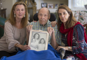 SAN FRANCISCO, Calif., October 5,  2016 Laura Rees (left) and her sister Nancy Fee (right) sit with their father, Joseph Fee, at his home in San Francisco on Oct. 5, 2016. They are holding an undated photo of their mother, Elizabeth Fee, taken when Laura and Nancy were children. Photo by Robert Durell