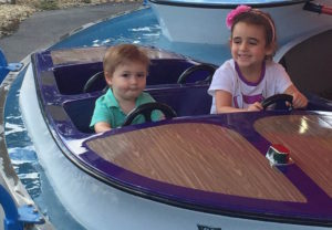 Aaron and Rayna get behind the wheel at an amusement park.