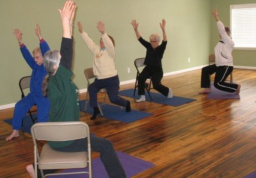 Oh my aching joints learn how chair yoga can help fifty for Chair yoga benefits