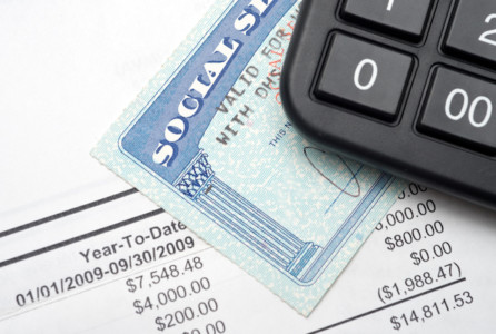 A calculator, social security, and financial statement.