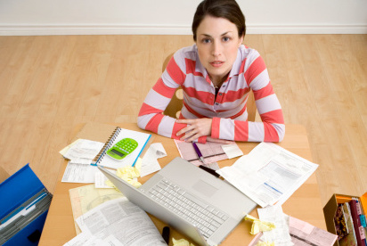 Woman with laptop and paperwork