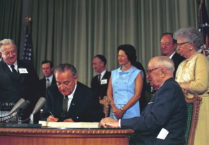 US president Lyndon B. Johnson signs the Medicare Bill into law in 1965, one of a suite of policies aimed at ending poverty in America. L