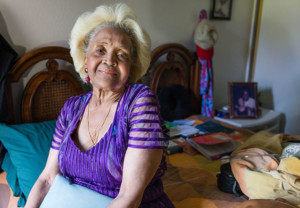 Esther Ellis sits on her bed at home in Hawthorne, Calif., on July 18, 2017. The 78-year-old received a new mattress earlier this year from Partners in Care, a nonprofit that runs four of the dozens of sites in California's Multipurpose Senior Services Program, a Medicaid-funded home services program. (Heidi de Marco/KHN)