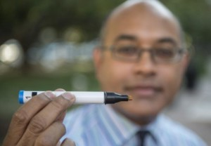 Jayant M. Pinto, MD, holds a Sniffin' Stick used for odor test.