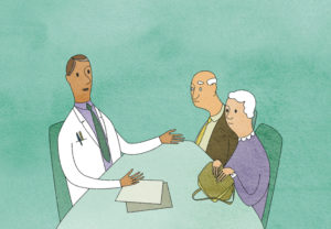 Doctor talking to elderly couple in doctors surgery