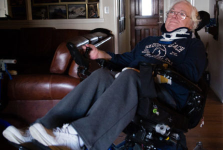 Colin Campbell at his home in Covina, Calif., on Dec. 18, 2017. Campbell was diagnosed with ALS eight years ago. He has Medicare due to his disability but can't use it for home care and instead is paying $4,000 a month for that service. His adjustable wheelchair allows him to recline, which makes breathing easier. (Heidi de Marco/KHN)