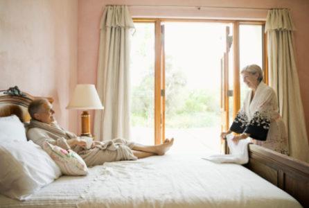 Couple in bathrobes in bedroom