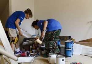Women preparing to paint walls