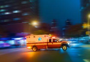 Ambulance speeding at night on an urgent call in Manhattan New York - motion blur panning action