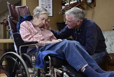 Stan Hugo with his wife, Donna, who is a resident at the Beechtree Center for Rehabilitation and Nursing in Ithaca, N.Y. Mr. Hugo tracks staffing levels at the skilled nursing facility. (Heather Ainsworth for The New York Times)