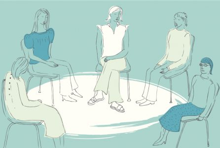 Women sitting together in a circle in support group