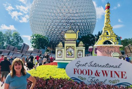 In front on Epcot geosphere during Food and Wine Expo