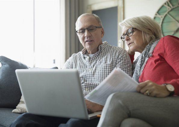 Finance, couple, computer, Medicare, enrollment
